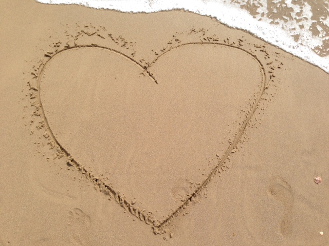 Beach heart etched in the sand